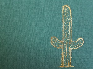 Gold foil embossed Cactus on the green fabric-wrapped cover